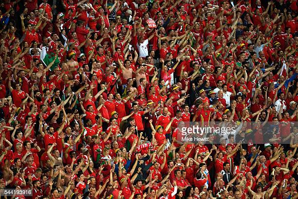 Wales supporters celebrate their team's win after the UEFA EURO 2016 quarter final match between Wales and Belgium at Stade PierreMauroy on July 1...
