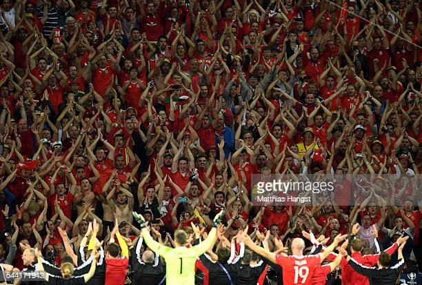 Wales supporters celebrate their team's win after UEFA EURO 2016 quarter final match between Wales and Belgium at Stade PierreMauroy on July 1 2016...