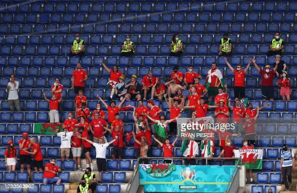 Wales supporters cheer during the UEFA EURO 2020 Group A football match between Italy and Wales at the Olympic Stadium in Rome on June 20, 2021.