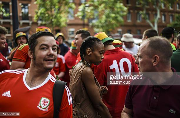Wales' supporters crowd in the streets of Toulouse southern France on June 20 2016 before the Euro 2016 football match of Russia vs Wales / AFP /...