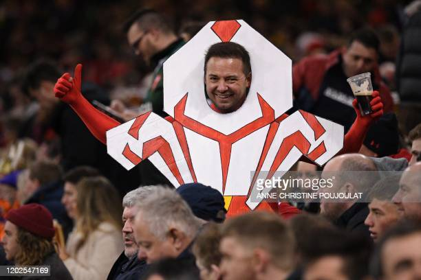 Wales supporters in costume gestures in the crowd before the Six Nations international rugby union match between Wales and France at the Principality...