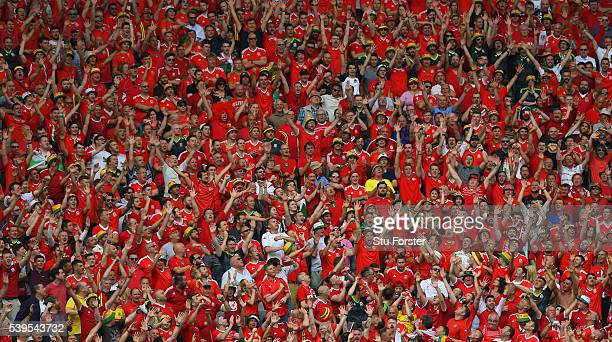 Wales supporters show their support during the UEFA EURO 2016 Group B match between Wales and Slovakia at Stade Matmut Atlantique on June 11 2016 in...
