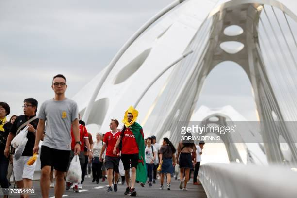 Wales supporters walk along the Toyota Bridge near the City of Toyota Stadium in Toyota City ahead of the Japan 2019 Rugby World Cup Pool D match...