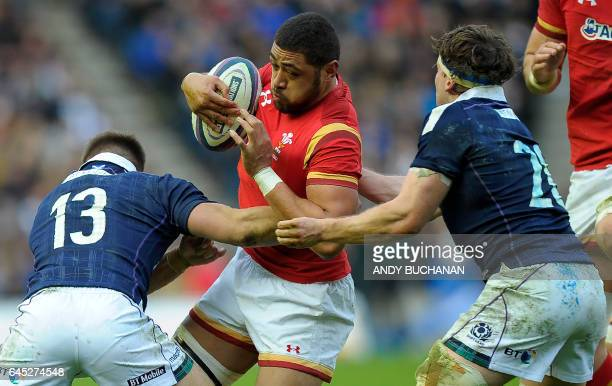 Wales' Taulupe Faletau vies with Scotland's center Huw Jones and Scotland's Hamish Watson during the Six Nations international rugby union match...