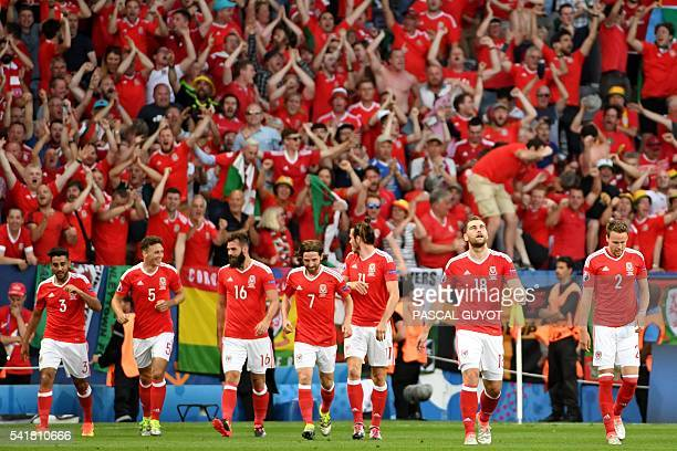 Wales team players celebrate a goal during the Euro 2016 group B football match between Russia and Wales at the Stadium Municipal in Toulouse on June...