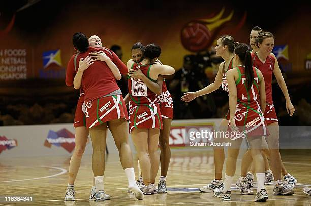 Wales team-mates celebrate after defeating Botswana on day five of the 2011 World Netball Championships at Singapore Indoor Stadium on July 7, 2011...