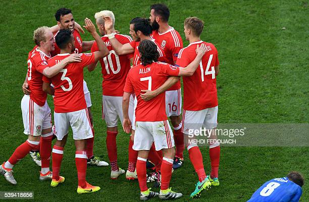 Wales' teammates celebrate their 21 win over Slovakia in the Euro 2016 group B football match between Wales and Slovakia at the Stade de Bordeaux in...