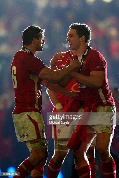 Wales teammates Sam Warburton and George North celebrate winning the Six Nations Championship during the RBS Six Nations match between Wales and...