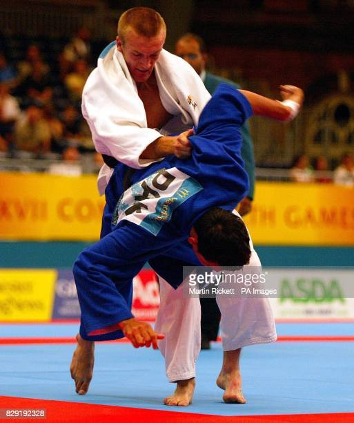 Wales' Tim Davies in action against Pakistan's Mohammed Butt in Commonwealth Games Mens 60kg Judo at the GMex Centre in Manchester