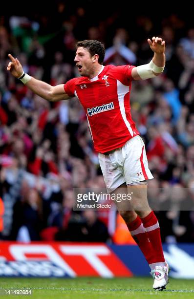 Wales tryscorer Alex Cuthbert celebrates victory as the final whistle blows during the RBS Six Nations Championship match between Wales and France at...