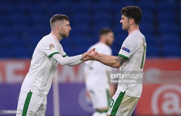 Wales , United Kingdom - 15 November 2020; Jack Byrne, left, comes on as a substitute for Republic of Ireland team-mate Robbie Brady during the UEFA...