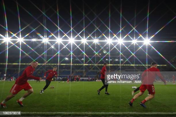 Wales warming up under the lights at the Cardiff City Stadium during the UEFA Nations League B group four match between Wales and Denmark at Cardiff...