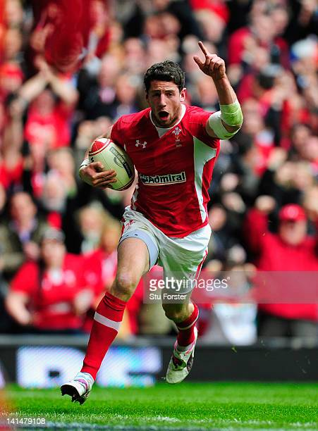Wales wing Alex Cuthbert celebrates as he scores the opening try during the RBS Six Nations match between Wales and France at the Millennium stadium...
