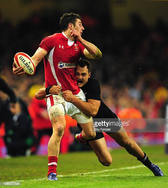 Wales wing Alex Cuthbert is tackled by Israel Dagg during the International Match between Wales and New Zealand at Millennium Stadium on November 24,...