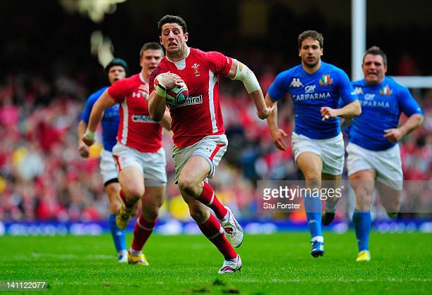 Wales wing Alex Cuthbert races away to score his try during the RBS Six Nations match between Wales and Italy at the Millennium stadium on March 10,...