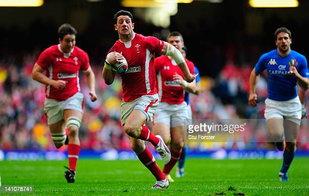 Wales wing Alex Cuthbert scores his try during the RBS Six Nations match between Wales and Italy at the Millennium stadium on March 10, 2012 in...