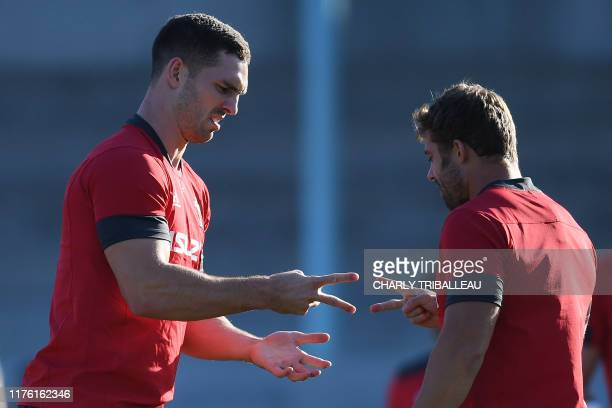 Wales' wing George North and full back Leigh Halfpenny play rock paper scissors during a training session in the Japanese southern city of Beppu on...