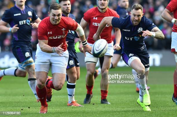 TOPSHOT Wales' wing George North and Scotland's Byron McGuigan chase the ball during the Six Nations international rugby union match between Scotland...