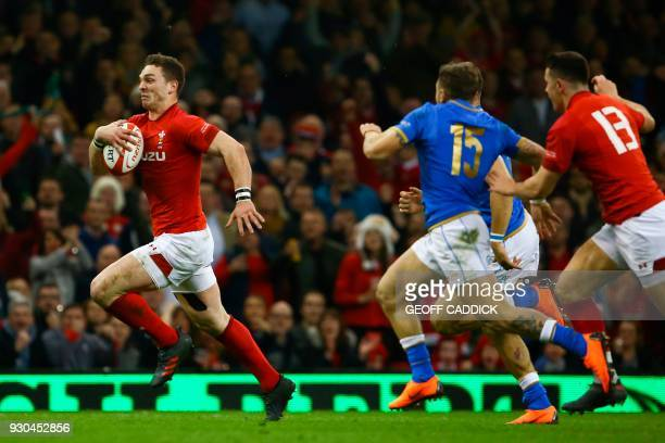 TOPSHOT Wales' wing George North runs through to score a try during the Six Nations international rugby union match between Wales and Italy at the...