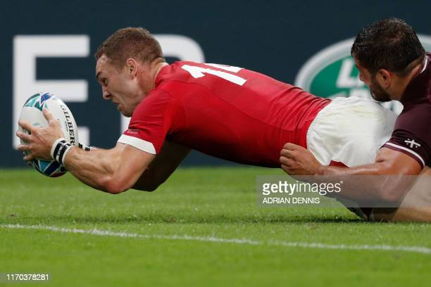 TOPSHOT Wales' wing George North scores a try during the Japan 2019 Rugby World Cup Pool D match between Wales and Georgia at the City of Toyota...