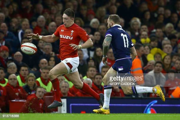 Wales' wing Josh Adams and Scotland's wing Byron McGuigan chase the ball during the Six Nations international rugby union match between Wales and...