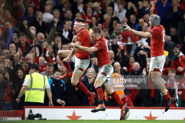 Wales' wing Josh Adams celebrates with Wales' fullback Liam Williams after scoring the winning try during the Six Nations international rugby union...
