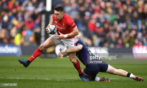 Wales wing Josh Adams races past Scotland player Nick Grigg during the Guinness Six Nations match between Scotland and Wales at Murrayfield on March...