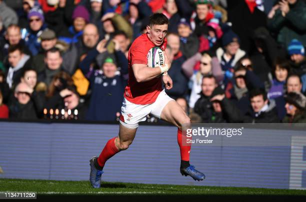 Wales wing Josh Adams scores the first Wales try during the Guinness Six Nations match between Scotland and Wales at Murrayfield on March 09 2019 in...