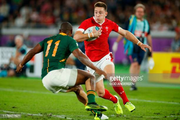 Wales' wing Joshua Adams attempts to run past South Africa's wing Makazole Mapimpi during the Japan 2019 Rugby World Cup semi-final match between...