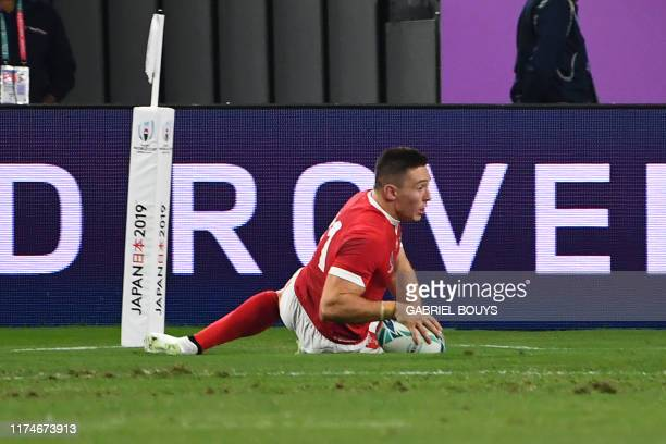 Wales' wing Joshua Adams scores a try during the Japan 2019 Rugby World Cup Pool D match between Wales and Fiji at the Oita Stadium in Oita on...