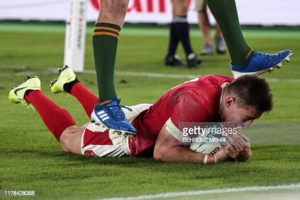 Wales' wing Joshua Adams scores a try during the Japan 2019 Rugby World Cup semifinal match between Wales and South Africa at the International...