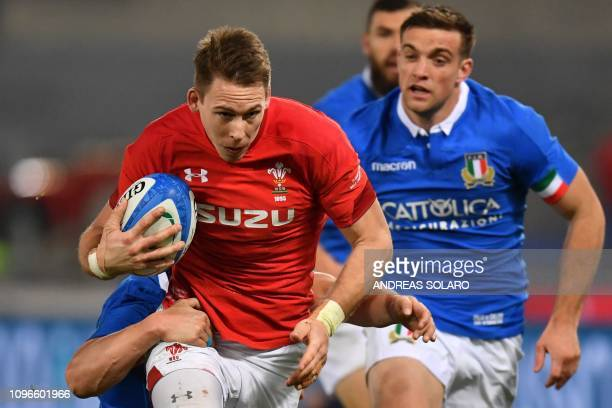 Wales' wing Liam Williams runs with the ball during the Six Nations rugby union tournament match between Italy and Wales at the Olympic stadium in...
