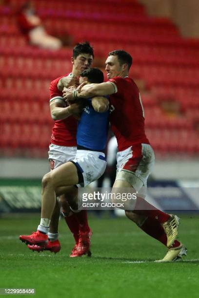 Wales' wing Louis Reed-Zammit and Wales' centre George North tackle Italy's full-back Jacopo Trulla during the Autumn Nations Cup international rugby...