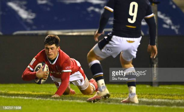 Wales wing Louis Rees-Zammit crosses for his first try during the Guinness Six Nations match between Scotland and Wales at Murrayfield on February...
