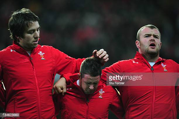 Wales wing Shane Williams sheds a tear during the national anthem flanked by Ryan Jones and Scott Andrew before the Test match between Wales and the...