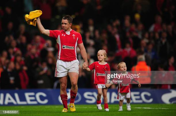 Wales wing Shane Williams waves to the crowd with his children on his lap of honour after the Test match between Wales and the Australian Wallabies...