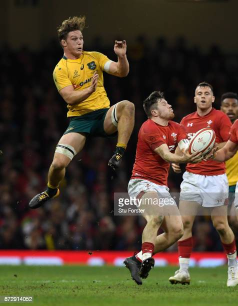 Wales wing Steff Evans takes a high ball despite the attentions of Michael Hooper during the International Match between Wales and Australia at...