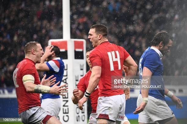 TOPSHOT Wales' winger George North celebrates after scoring a try during the Six Nations rugby union tournament match between France and Wales at the...