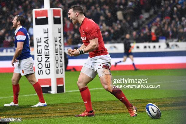 Wales' winger George North celebrates after scoring a try during the Six Nations rugby union tournament match between France and Wales at the stade...
