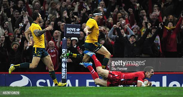 Wales winger George North crosses for the first Wales try during the International match between Wales and Australia Wallabies at Millennium Stadium...