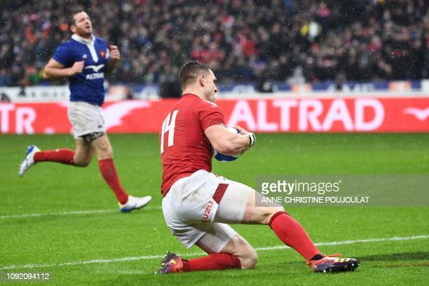 Wales' winger George North scores a try during the Six Nations rugby union tournament match between France and Wales at the stade de France in Saint...