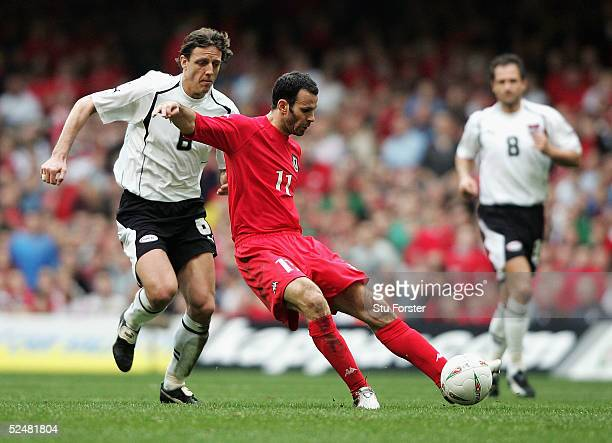 Wales winger Ryan Giggs gets in a shot at goal watched by Rene Aufhauser of Austria during the Group Six World Cup Qualifiying match between Wales...