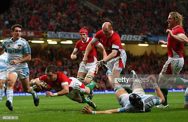 Wales winger Shane Williams dives over to score a try during the International Rugby Union match between Wales and Argentina at Millennium Stadium on...