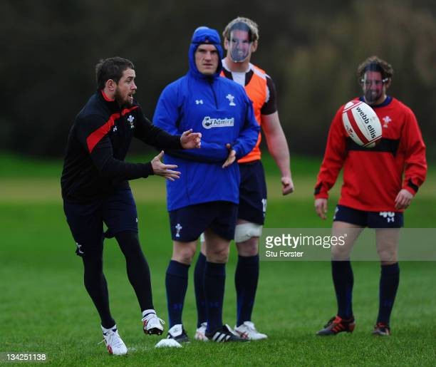 Wales winger Shane Williams in action with his team mates who all wore Shane Williams masks at Wales training to mark 'Shane Williams day' ahead of...