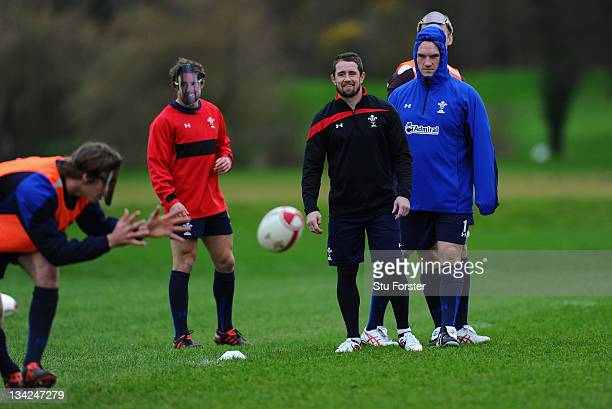 Wales winger Shane Williams shares a joke with his team mates who all wore Shane Williams masks at Wales training to mark 'Shane Williams day' ahead...