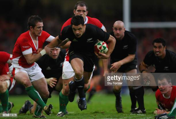 Wales winger Shane Williams tackles all blacks fly half Dan Carter to the floor during the Invesco Perpetual series match between Wales and New...