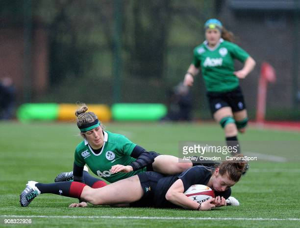Wales womens Lisa Neumann is tackled by Ireland womens Alison Miller during the Rugby Womens Friendly match between Wales Women and Ireland Women on...