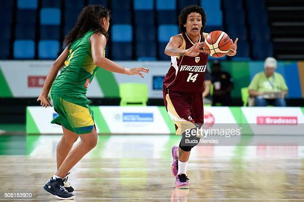 Waleska Perez of Venezuela drives the ball against Iziane Castro of Brazil during International Womens Basketball Tournament Aquece Rio Test Event...