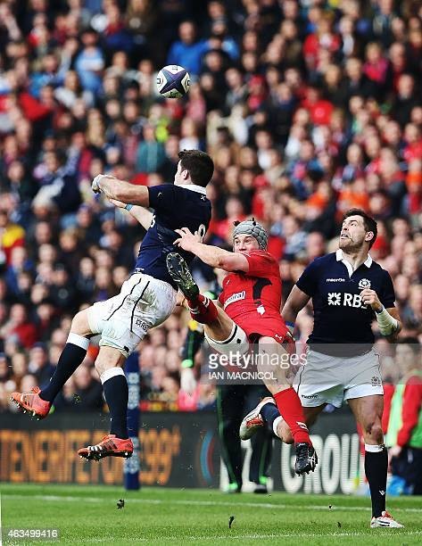 Wales's centre Jonathan Davies jumps unfairly against Scotland's number 8 Johnnie Beattie to earn a yellow card during the Six Nations international...