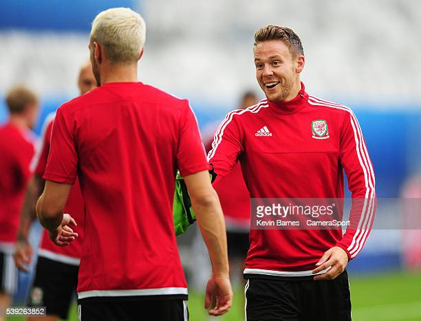 Wales's Chris Gunter hands a bib to Wales's Aaron Ramsey during the training session at the Stade de Bordeaux on June 10 2016 in Bordeaux France...